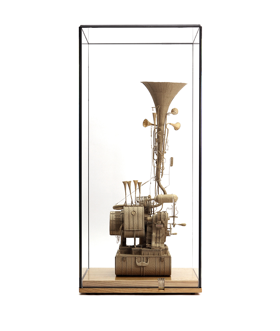 Daniel Agdag, Machine / Instrument No. 3 2018<br> Cardboard, paper, brass, nickel, 11 jewel Hermle carriage movement. Mounted on wooden base (Victorian Ash) under low iron glass<br>65cm x 30.5cm x 30.5cm (including glass vitrine)