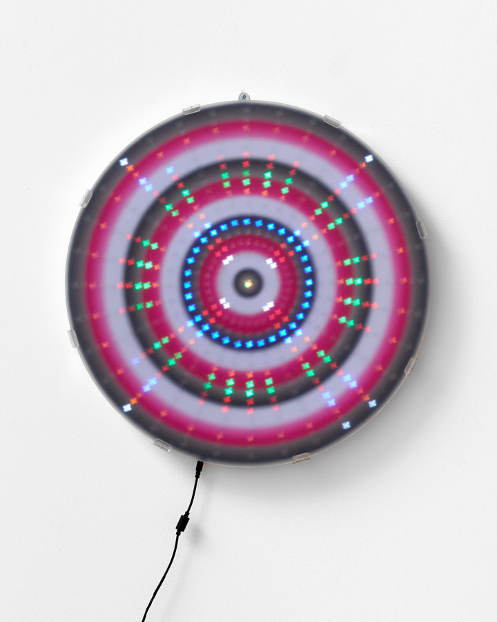 'Mandala for the Lost – Big Progress / Pathways for your Future / Pre-packaged Deals/ Happy People [Mantra reads Black / White / Pink / Black Repeat]', 2015<br>Animated Led lightwork, digital print, Perspex vinyl gel 'haze screen'<br>60cm diameter