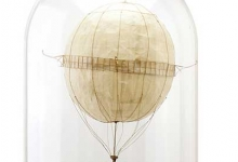 SOLD   'The Unicycle', 2014, cardboard, trace paper mounted on wooden base with hand-blown glass dome, 58.5 x 30.5 cm
