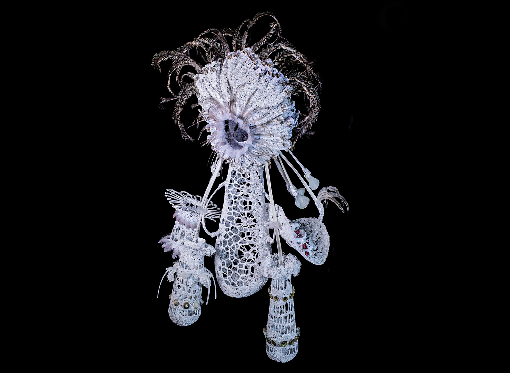 Jenny Crompton, Min Murrup <br /> painted copper wire, emu feathers, shells, roo bones, beads and balsa wood, 120 x 65 x 65 cm