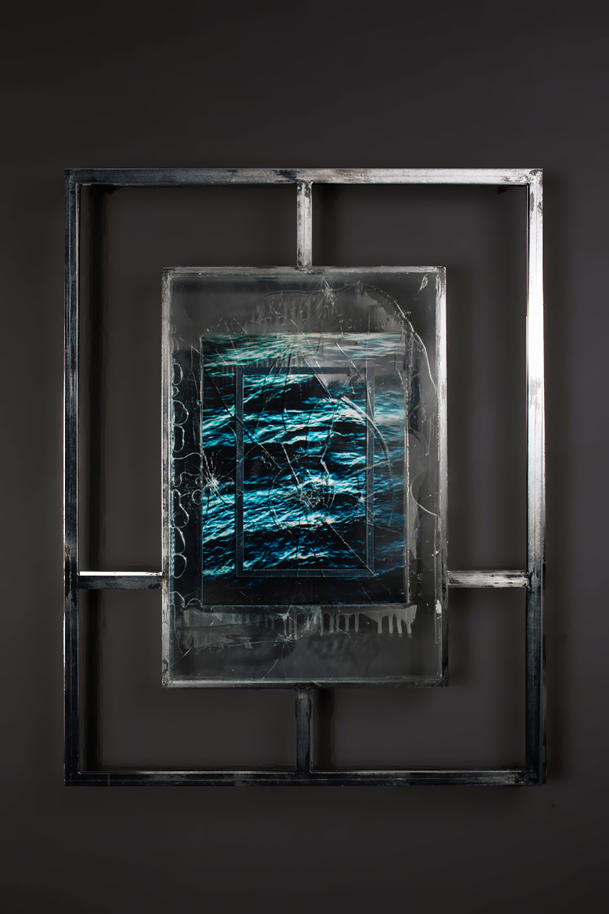 T I M E T O M B V<br>2016, chrome plated steel, shattered glass, UV resistant resin, mirrored vinyl, perspex, ocean water, sadness, etc.<br>700 x 900mm