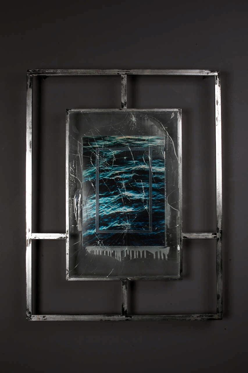 T I M E T O M B I<br>2016, chrome plated steel, shattered glass, UV resistant resin, mirrored vinyl, perspex, ocean water, sadness, etc.<br>700 x 900mm