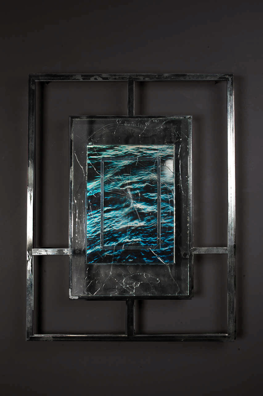 T I M E T O M B II<br>2016, chrome plated steel, shattered glass, UV resistant resin, mirrored vinyl, perspex, ocean water, sadness, etc.<br>700 x 900mm