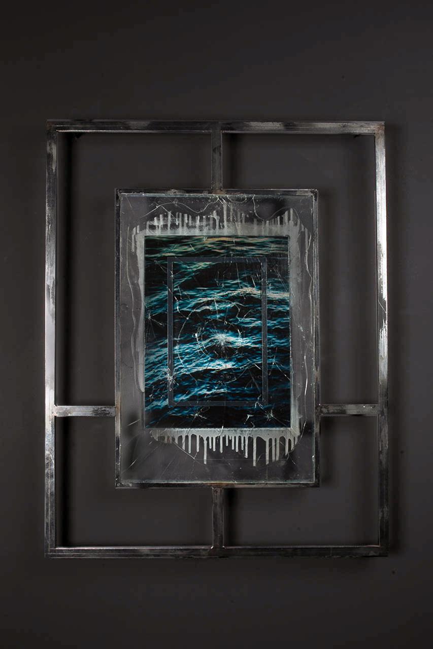 T I M E T O M B III<br>2016, chrome plated steel, shattered glass, UV resistant resin, mirrored vinyl, perspex, ocean water, sadness, etc.<br>700 x 900mm