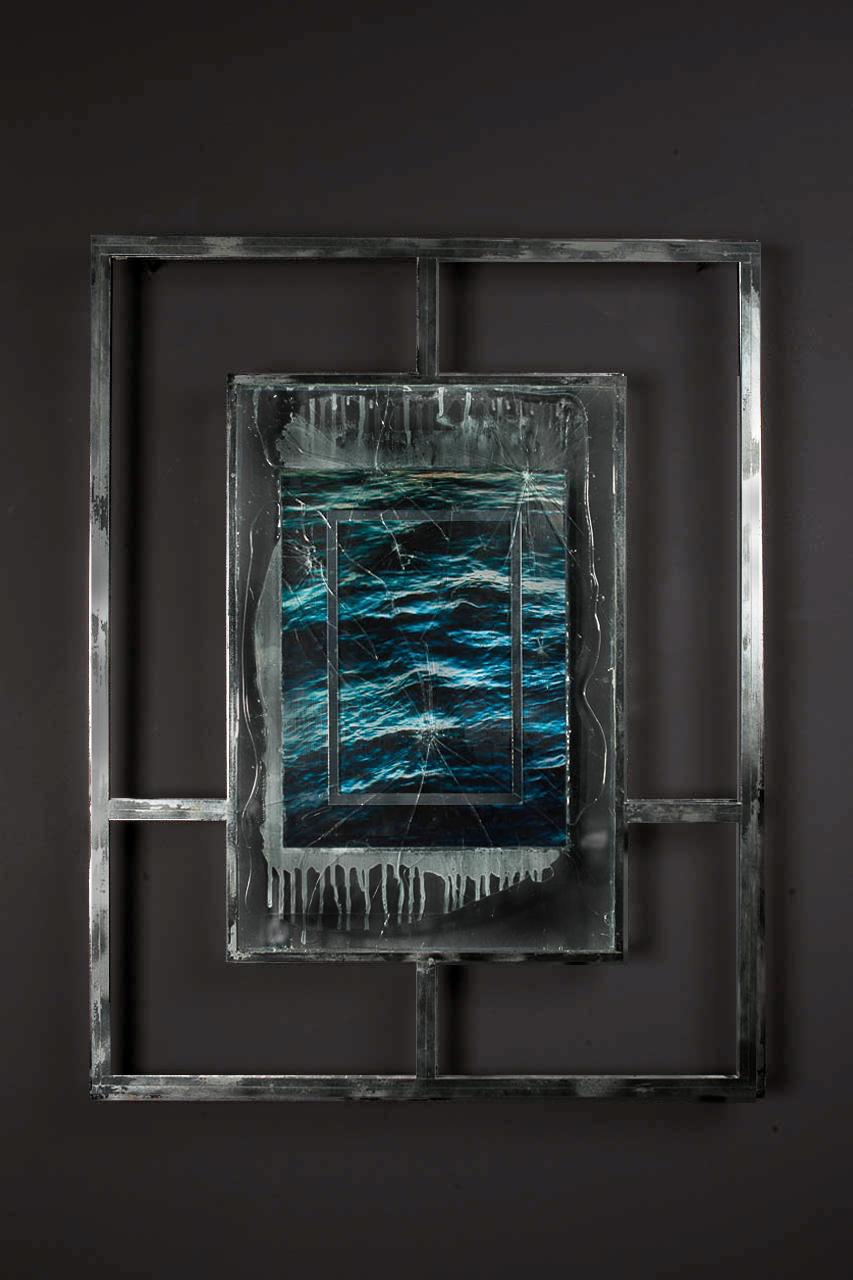 T I M E T O M B IV<br>2016, chrome plated steel, shattered glass, UV resistant resin, mirrored vinyl, perspex, ocean water, sadness, etc.<br>700 x 900mm