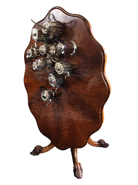 Megan Evans, The Whispering in our Hearts, 2018<br/>Victorian antique mahogany tilt top table, antique silver tea pots, coffee pots, brass fixtures, dimensions variable