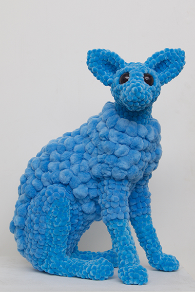 big eyed blue coated digger, 2017<br>polyurethane, polyester pompoms, glue, glass eyes, plastic ear liners, 55 x 45 x 25 cm