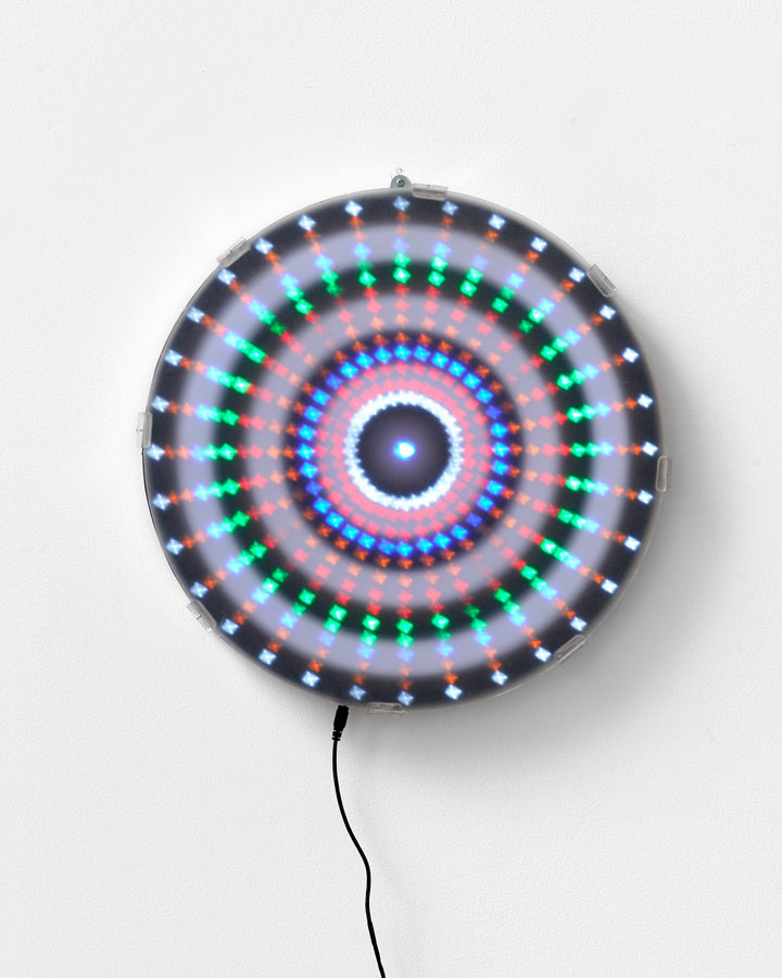 'Mandala for the Lost - Unfortunately history does repeat [Mantra reads Black White Black White repeat] education modules and colonial hangovers – we can fix it...', 2015<br/>Animated Led lightwork, digital print, Perspex vinyl gel 'haze screen'<br/>45cm diameter