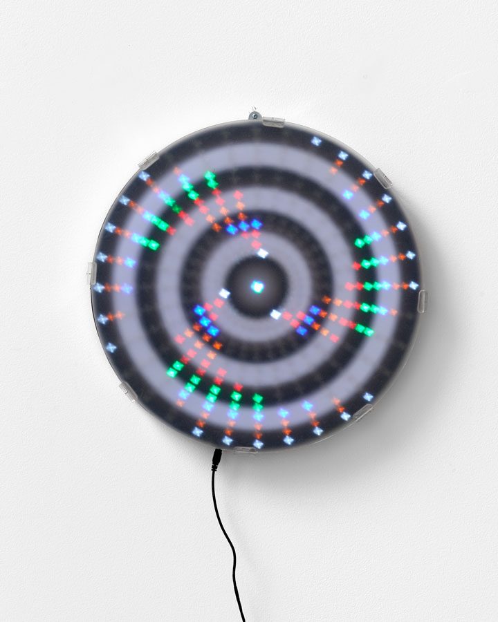 'Mandala for the Lost -Unfortunately history does repeat [Mantra reads Black / White / Black / White repeat] Sitting in comfortably in a renovated Victorian building waiting for things to change...', 2015<br/>Animated Led lightwork, digital print, Perspex vinyl gel 'haze screen'<br/>45cm diameter