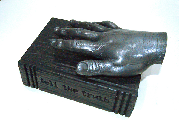 TELL THE TRUTH, 2018<br>cold cast aluminium, wood, graphite and bible, 12 x 25 x 16 cm, edition of 3 +1AP