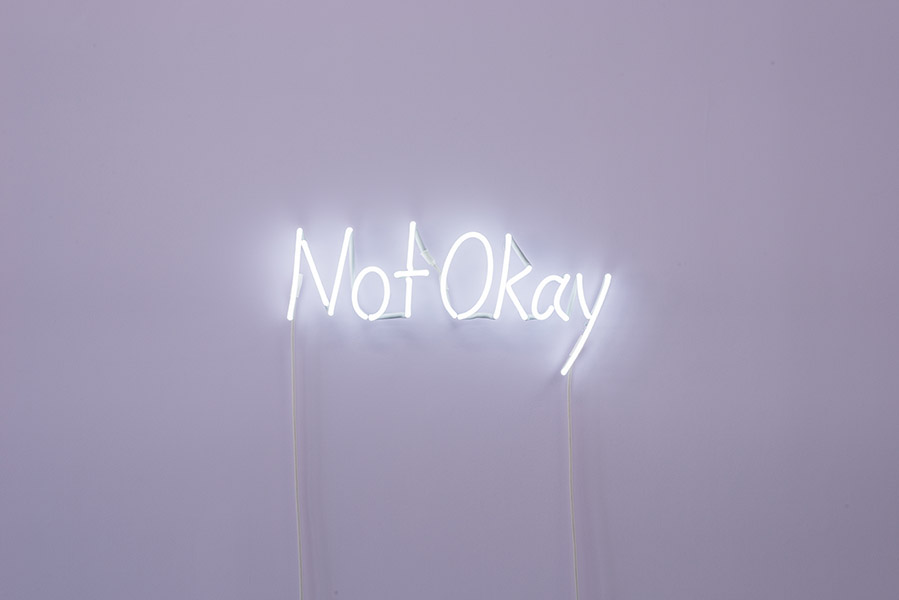 Kate Just, Not Okay, 2018<br/>Neon sign, 20 x 75 cm, photograph by Simon Strong