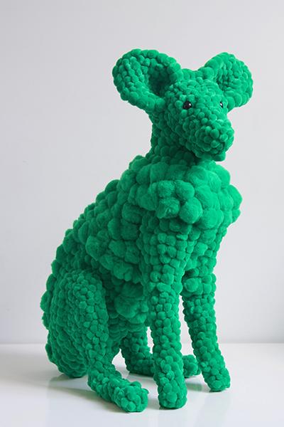 green plant eater, 2017<br/>polyurethane, polyester pompoms, glue, glass eyes, plastic ear liners, 52 x 35 x 27 cm